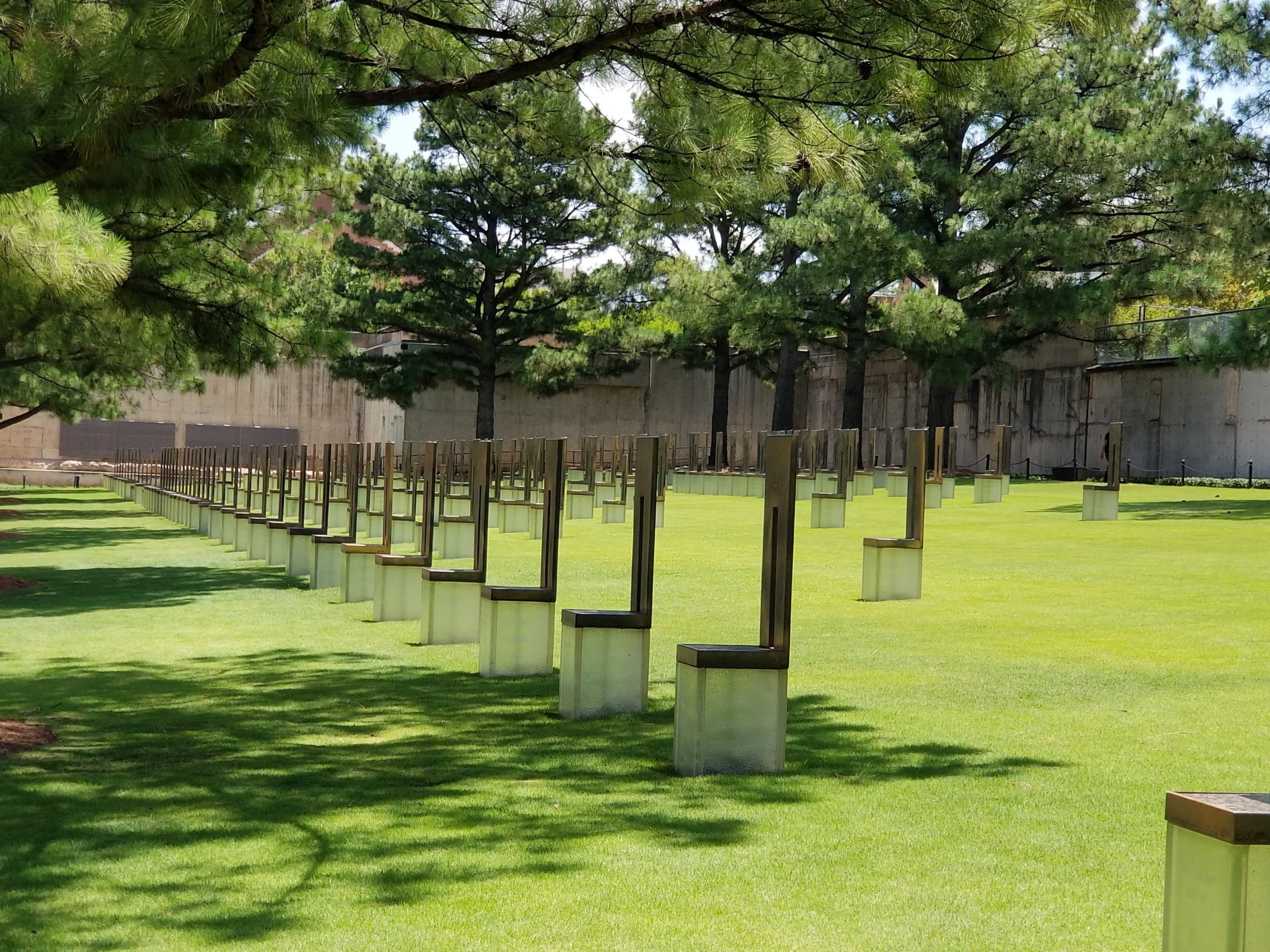The 168 Chairs represent those killed on April 19, 1995. They stand in nine rows, each representing a floor of the Federal Building where the field is now located. Each chair bears the name of someone killed on that floor. Nineteen smaller chairs stand for the children. ..........................................
